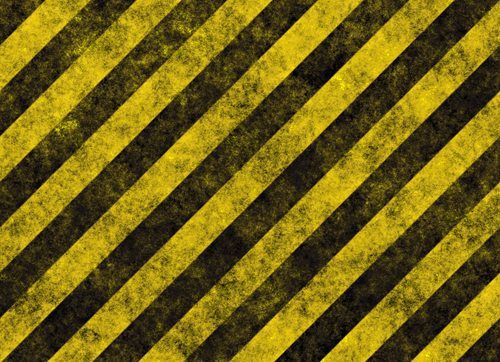 yellow hazard stripes on black road